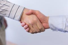 Handshaking. Image of handshaking of business partners stock photo