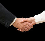 Handshaking man and woman Royalty Free Stock Photography