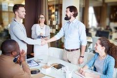 Handshaking at meeting Royalty Free Stock Image