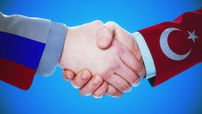 Russia - Turkey / Handshake concept animation about countries and politics / With matte channel. Handshaking of the men wearing flag pattern suit 4K animation stock footage