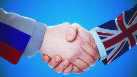 Russia - United Kingdom  / Handshake concept animation about countries and politics / With matte channel. Handshaking of the men wearing flag pattern suit 4K stock video