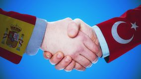 Spain - Turkey / Handshake concept animation about countries and politics / With matte channel. Handshaking of the men wearing flag pattern suit 4K animation stock video footage
