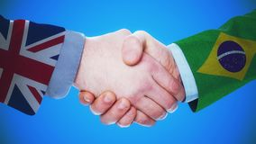 United Kingdom - Brazil / Handshake concept animation about countries and politics / With matte channel. Handshaking of the men wearing flag pattern suit 4K stock video
