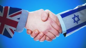 United Kingdom - Israel / Handshake concept animation about countries and politics / With matte channel. Handshaking of the men wearing flag pattern suit 4K stock video footage