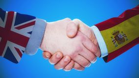 United Kingdom - Spain / Handshake concept animation about countries and politics / With matte channel. Handshaking of the men wearing flag pattern suit 4K stock footage