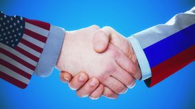United States - Russia / Handshake concept animation about countries and politics / With matte channel. Handshaking of the men wearing flag pattern suit 4K stock footage