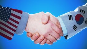 United States - South Korea / Handshake concept animation about countries and politics / With matte channel. Handshaking of the men wearing flag pattern suit 4K stock video