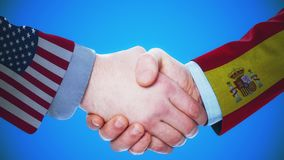United States - Spain / Handshake concept animation about countries and politics / With matte channel. Handshaking of the men wearing flag pattern suit 4K stock video