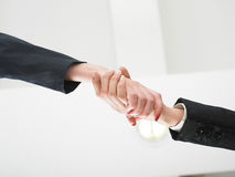 Handshaking in office low angle Royalty Free Stock Photos