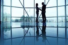 Handshaking in office Stock Image
