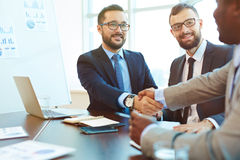 Handshaking with partner Royalty Free Stock Photo