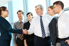 Handshaking partners Stock Photos