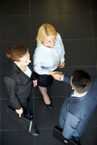 Handshaking partners. Image of business partners handshaking after signing contract Royalty Free Stock Images