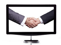 Handshaking on the screen. Two businessman handshaking on the screen Stock Images