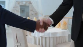 Handshaking of two businessmen stock footage