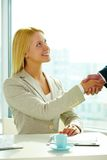 Handshaking woman Royalty Free Stock Images