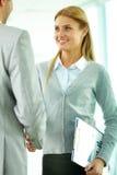 Handshaking woman Stock Images