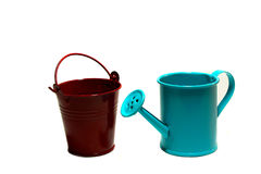 Handshower and garden bucket on a white background. Blue garden handshower and a red bucket on a white background Stock Photography