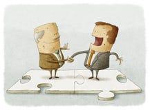 Handskakning för pussel för affärsfolk Arkivbild