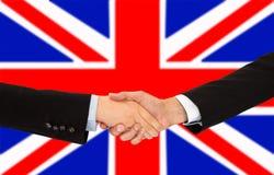 Handskakning i UK Royaltyfri Bild