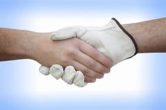 Handskakning med arbetaren Royaltyfria Foton