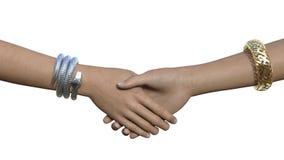 Handskakning med armband på Fotografering för Bildbyråer