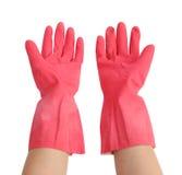 Handskar för att göra ren med handen på vit bakgrund Royaltyfria Bilder