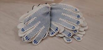 Handskar för hushåll, reparation och industriellt arbete royaltyfri bild