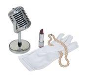 handskeläppstiftmikrofonen pryder med pärlor white arkivfoto