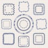 Handsketched-Gekritzel-Rahmen Vier Schneeflocken auf weißem Hintergrund Lizenzfreie Stockfotos