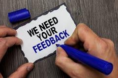 Handskrifttext behöver vi din återkoppling Begreppsbetydelsen ger oss dina granskningtankar kommentarer vad för att förbättra det royaltyfri fotografi