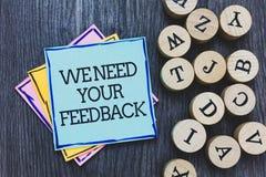 Handskrifttext behöver vi din återkoppling Begreppsbetydelsen ger oss dina granskningtankar kommentarer vad för att förbättra sva royaltyfri fotografi