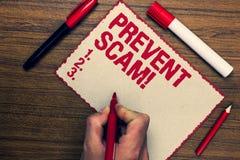 Handskrifttext förhindrar Scam den Motivational appellen För konsumentskydd för begrepp menande nic för pennor för markör för tra Fotografering för Bildbyråer