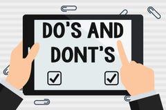 Handskrifttext g?r S och g?r inte S Begrepp som betyder regler eller egenar ang?ende n?got aktivitet eller handlinghandinnehav stock illustrationer
