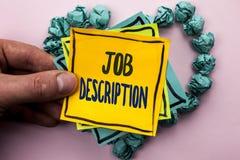 Handskrifttext Job Description Begreppsbetydelsedokument som upprättar arbetsuppgiftkravexpreriencen som är skriftlig på klibbig  Arkivbild