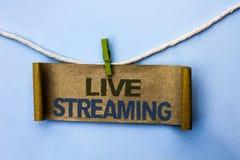 Handskrifttext Live Streaming Teknologi för multimedia för överföringen för menande massmedia för begreppet sänder realtidsskrift arkivfoto