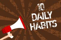 Handskrifttext som skriver 10 dagliga vanor Begreppet som betyder bra näring för den sunda rutinmässiga livsstilen, övar den håll arkivfoton