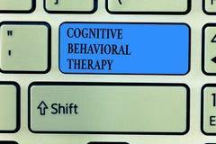 Handskrifttext som skriver kognitiv beteende- terapi Begrepp som betyder psykologisk behandling för psykiska störningar royaltyfria bilder
