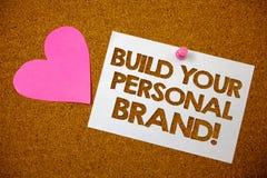 Handskrifttextbyggande din Motivational appell för personligt märke Begreppsbetydelsen som skapar lyckade rosa färger för företag arkivbild