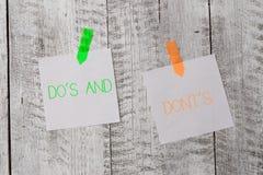 Handskrifttexthandstil g?r S och g?r inte S Begrepp som betyder regler eller egenar angående några rikliga aktivitet eller handli arkivbild