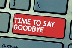 Handskrifttexthandstil Tid som säger farväl Begreppsbetydelsen som bjuder avsked ser så länge att du att bruka oss möter igen fotografering för bildbyråer