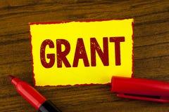 Handskrifttextlån Menande pengar för begrepp som ges av en organisation eller en regering för ett avsiktstipendium som är skriftl arkivbild
