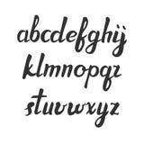 Handskriven borstestilsort för vektor Svarta bokstäver över vit alfabet tecknade handbokstäver moderiktig abc litet Royaltyfria Bilder