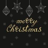 Handskriven guld- bokstäver för glad jul med triangelkonst D Royaltyfria Foton