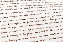 Handskriven italiensk text för bakgrund arkivbild