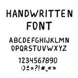 Handskriven marköralfabetstilsort Arkivbild