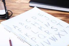 handskrivet alfabet Arkivfoto