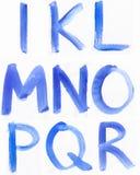Handskrivet blått vattenfärgalfabet royaltyfri foto