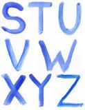 Handskrivet blått vattenfärgalfabet royaltyfri bild