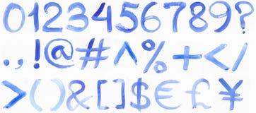 Handskrivet blått vattenfärgalfabet arkivfoton